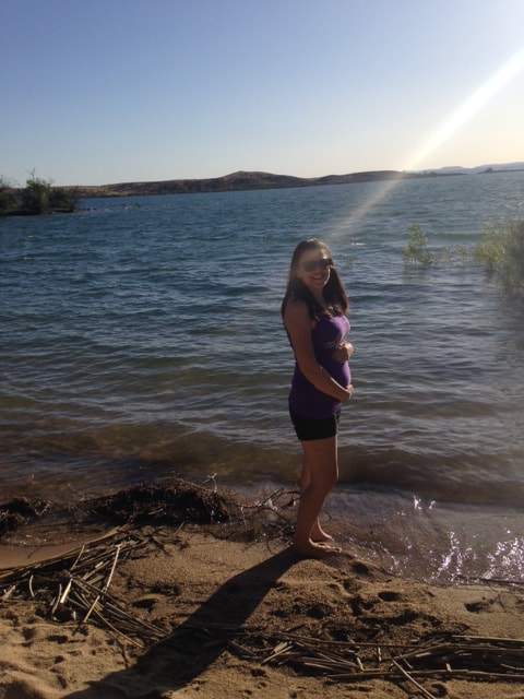 Shannon Landis, Golden State Surrogacy CEO, pregnant by a lake